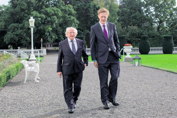 President Michael D Higgins strolling with Fionnan Sheahan in the grounds of Aras an Uachtarain.