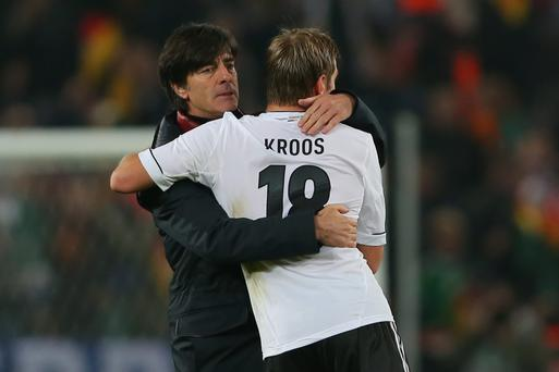 Joachim Loew celebrates victory Toni Kroos after the FIFA 2014 World Cup Qualifier Group C match between Germany and Republic of Ireland in Cologne