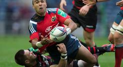 Munster's Simon Zebo is tackled by Edinburgh's Cornell du Preez during the Heineken Cup match at Murrayfield, Edinburgh