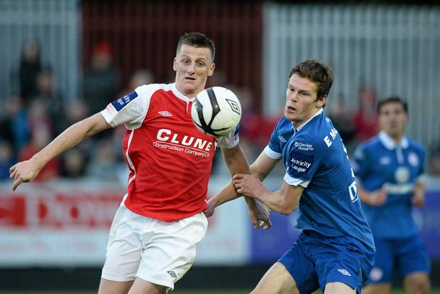 Anto Flood, St. Patrick's Athletic, in action against Evan McMillan, Sligo Rovers