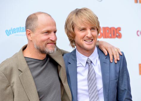 "Actors Woody Harrelson (L) and Owen Wilson arrive at the premiere of Relativity Media's ""Free Birds"" at the Westwood Village Theatre on October 13, 2013 in Hollywood, California. (Photo by Alberto E. Rodriguez/Getty Images for Relativity Media)"