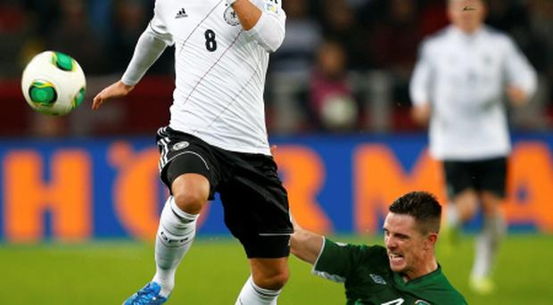 Ireland's Ciaran Clark challenges Germany's Mesut Ozil during their World Cup qualifier