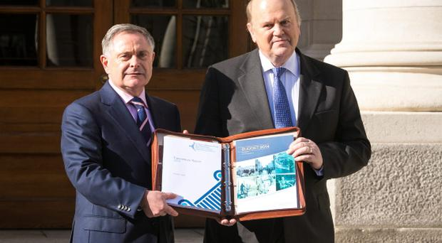Minister for Public Expenditure and Reform Brendan Howlin with Minister For Finance Michael Noonan at the announcement of Budget 2014