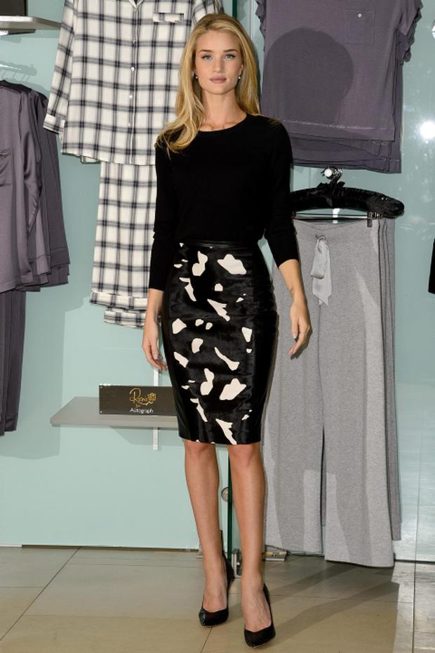 LONDON, ENGLAND - OCTOBER 16: Rosie Huntington Whiteley attends a photocall to launch her range of lingerie and nightwear for Marks & Spencer at Marks & Spencer Marble Arch on October 16, 2013 in London, England. (Photo by Ben A. Pruchnie/Getty Images)