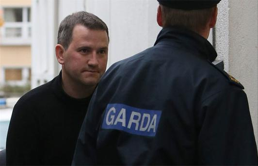 Graham Dwyer, 41, appears at Dun Laoghaire District Court in Dublin charged with the murder of Elaine O'Hara