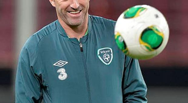 Robbie Keane smiles during the last training session before the 2014 World Cup Group C qualifying soccer match against Germany