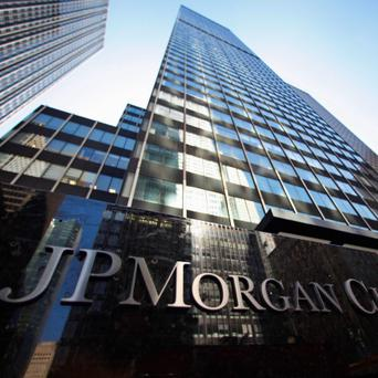 A sign outside the headquarters of JP Morgan Chase & Co in New York, in this September 19, 2013 file photo.