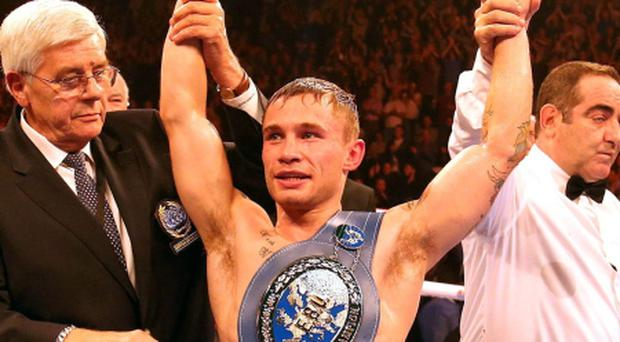Carl Frampton celebrates after beating France's Jeremy Parodi during their IBF Super Bantamweight bout at the Odyssey Arena, Belfast