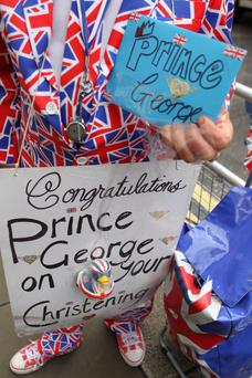 Royal Fan Terry Hutt shows off his signs outside the gates of St James's Palace in London as he waits for the start of the christening of Prince George of Cambridge. PRESS ASSOCIATION Photo. Picture date: Wednesday October 23, 2013. See PA story ROYAL Christening. Photo credit should read: Sean Dempsey/PA Wire
