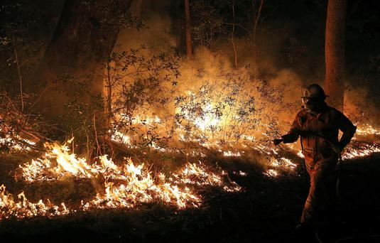 Firefighters control flames during hazard reduction in Bilpin 75 kilometers (46 miles) from Sydney