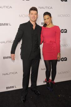 NEW YORK, NY - OCTOBER 23: Singer Robin Thicke and actress Paula Patton walk the red carpet at the 2013 GQ Gentlemen's Ball presented by BMW i, Movado, and Nautica at IAC Building on October 23, 2013 in New York City. (Photo by Dimitrios Kambouris/Getty Images for GQ)