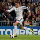 Real Madrid's Gareth Bale runs with the ball during his Champions League soccer match against Juventus last night