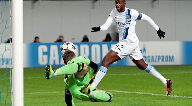 Manchester City's Yaya Toure, right, closes in on the ball as Moscow goalkeeper Igor Akinfeev dives during the UEFA Champions League group D soccer match between CSKA Moscow and Manchester City, at Arena Khimki stadium outside Moscow