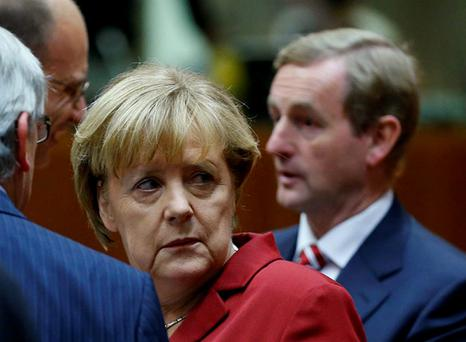 Chancellor Angela Merkel and Taoiseach Enda Kenny at the EU summit in Brussels yesterday. The growing phone-tap furore could derail a potential transatlantic trade deal.