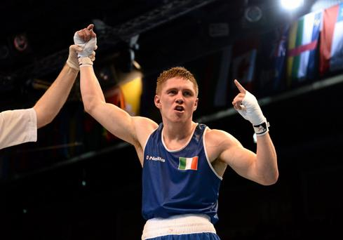 25 October 2013; Jason Quigley, Finn Valley BC, Donegal, representing Ireland, celebrates after beating Artem Chebotarev, Russia, in their Men's Middleweight 75Kg Semi-Final bout. AIBA World Boxing Championships Almaty 2013, Almaty, Kazakhstan. Picture credit: Paul Mohan / SPORTSFILE