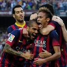 FC Barcelona's Neymar, right, reacts after scoring against Real Madrid with his teammates Daniel Alves, second left, and Sergio Busquets