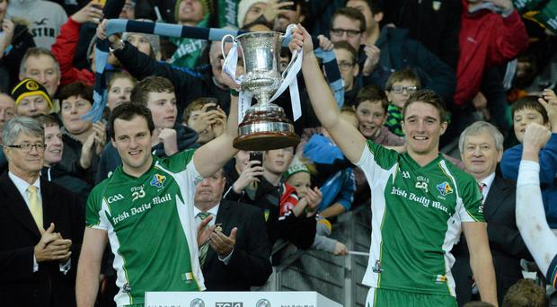Ireland captain Michael Murphy, left, and Aidan Walsh lift the Cormac McAnallen cup last October