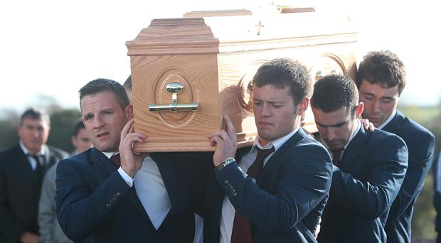 Galway inter county players carry the coffin of their teammate, Niall Donoghue at his funeral at St Columba's Church in Kilbeacanty, Co. Galway.