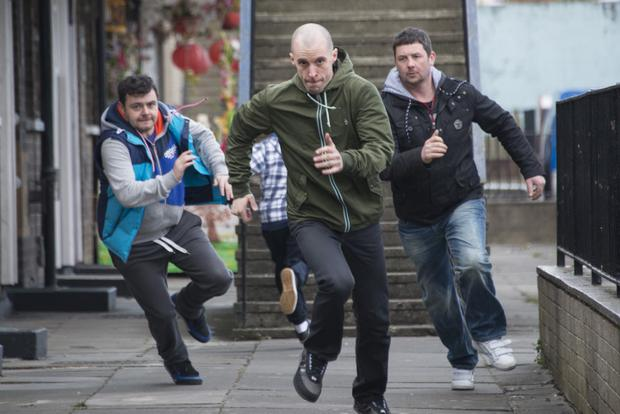 Gang make a run for it Laurence Kinlan as Elmo, Tom Vaughan-Lawlor as Nidge and Mark Dunne as Ado