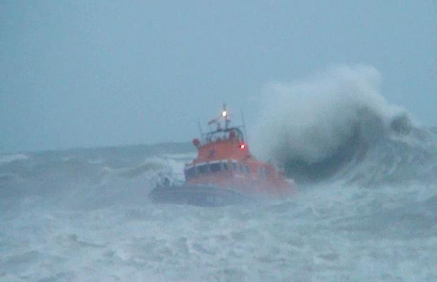 RNLI Newhaven lifeboat searching for a missing teenager who was washed into the sea this afternoon at West Beach, Newhaven.