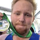 Jason Kennedy of Independent.ie is proud of his medal at the finish line