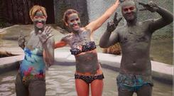 Amanda shows off the secrets to her skin success by indulging in a mud bath while in New Zealand