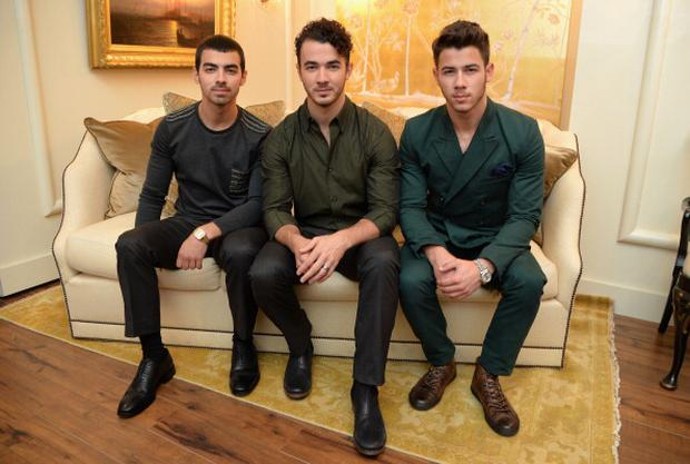 Joe Jonas, Kevin Jonas, and Nick Jonas of the Jonas Brothers attend the Mercedes-Benz Star Lounge during Mercedes-Benz Fashion Week Spring 2014 at Lincoln Center on September 5, 2013 in New York City. (Photo by Mike Coppola/Getty Images for Mercedes-Benz)