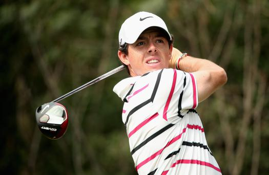 Rory McIlroy of Northern Ireland hits his tee-shot on the 11th hole at the Sheshan International Golf Club in Shanghai today