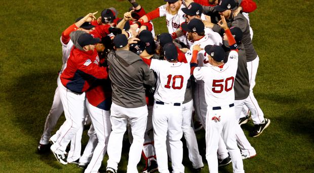 The Boston Red Sox react after defeating the St. Louis Cardinals in game six of the MLB baseball World Series at Fenway Park. Red Sox won 6-1