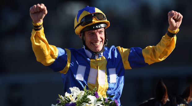 Richard Hughes celebrates atop Chriselliam after winning the Juvenile Fillies Turf during the 2013 Breeders' Cup World Championships at Santa Anita Park tonight