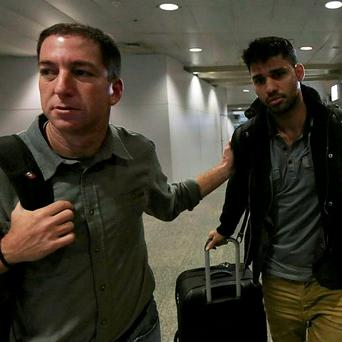 Journalist Glenn Greenwald (left) pictured with his partner David Miranda in Rio de Janeiro's International Airport in this August 19, 2013