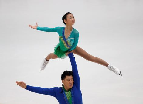 China's Peng Cheng (top) and Zhang Hao perform at the pairs short programme