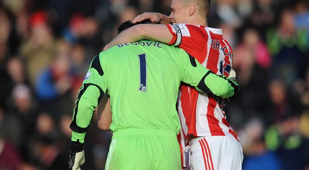 Asmir Begovic (L) of Stoke City is congratulated by team-mate Ryan Shawcross after scoring the opening goal during the Barclays Premier League match between Stoke City and Southampton