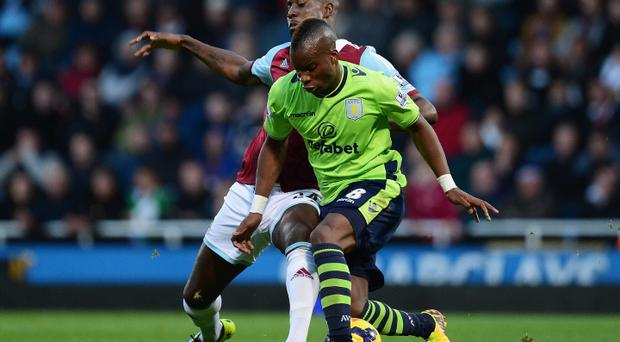 Yacouba Sylla of Aston Villa is challenged by Carlton Cole of West Ham United during the Barclays Premier League match between West Ham United and Aston Villa at the Boleyn Ground on November 2, 2013 in London, England. (Photo by Jamie McDonald/Getty Images)