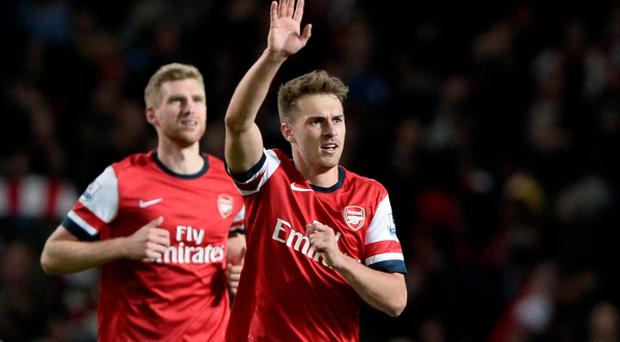 Arsenal's Aaron Ramsey (R) celebrates after scoring a wonder goal against Liverpool