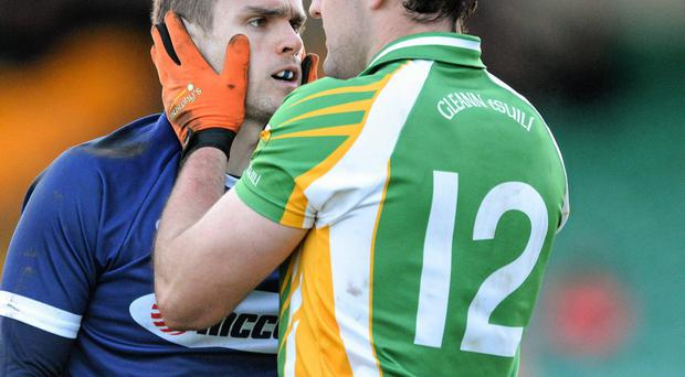 3 November 2013; Michael Murphy, Glenswilly, consoles Colin Brady, St Galls. AIB Ulster Senior Club Football Championship, Quarter-Final, Glenswilly, Donegal v St Galls, Antrim. MacCumhaill Park, Ballybofey, Co. Donegal. Picture credit: Oliver McVeigh / SPORTSFILE