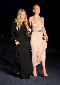 Singer/songwriter Fergie and actress Kate Hudson attend the LACMA 2013 Art + Film Gala honoring Martin Scorsese and David Hockney presented by Gucci at LACMA on November 2, 2013 in Los Angeles, California. (Photo by Jason Merritt/Getty Images for LACMA)
