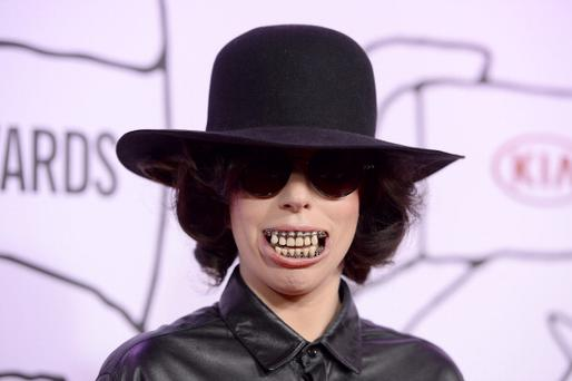Lady Gaga shows off her creepy set of teeth