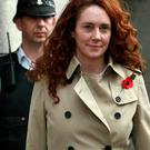 Former News International chief executive Rebekah Brooks leaves the Old Bailey courthouse in London November 1, 2013. Andy Coulson, then editor of Rupert Murdoch's News of the World, instructed a journalist working on a story about a celebrity to
