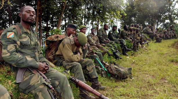 Congolese soldiers rest while being deployed against the M23 rebels near Bunagana, north of Goma