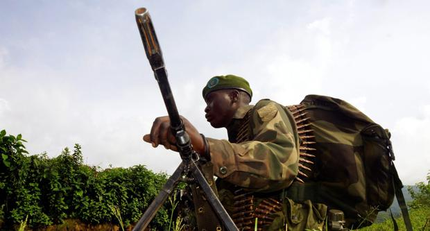 A Congolese soldier holds a position against the M23 rebels near Bunagana