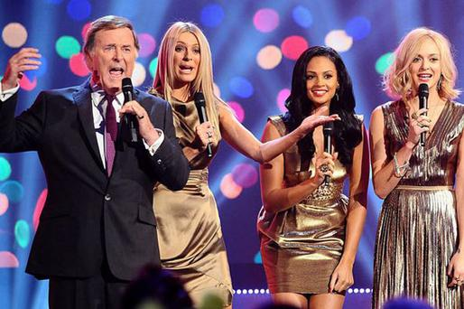 Terry Wogan says young female presenters use their looks to get tv roles