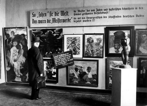A man looks at pieces from the Nazi-curated travelling exhibition, 'Degenerate Art,' (Entartete Kunst) at its second stop at the Haus der Kunst in Berlin February 24 1938. A vast collection of modern art branded 'degenerate' and seized by the Nazis which includes works by Picasso, Matisse and Chagall has been discovered in a Munich flat amongst stacks of rotting groceries, German magazine Focus reported on Monday