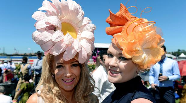 Gail Langton, left, and Aimee Skaines from Queensland pose on the lawn of the Flemington Racecourse before the Melbourne Cup horse race in Melbourne