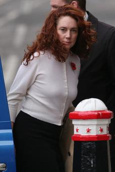 LONDON, ENGLAND - NOVEMBER 01: Former News International chief executive Rebekah Brooks arrives at the Old Bailey for the phone-hacking conspiracy trial on November 1, 2013 in London, England. Downing Street's former director of communications and News Of The World editor Andy Coulson and the former News International chief executive Rebekah Brooks, along with six others, face a series of charges linked to phone hacking celebrities and those in the news at the now-defunct newspaper. A six year affair, believed to have begun in 1998 between Mrs Brooks and Mr Coulson was revealed yesterday in court. (Photo by Oli Scarff/Getty Images)