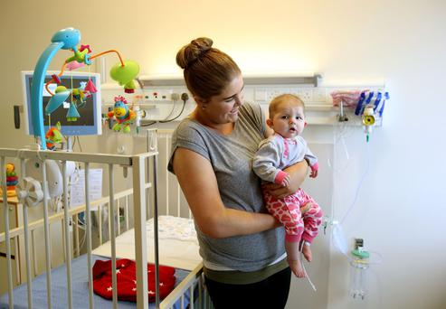 Nevaeh Fox, 7 months from Kells, Co. Meath, who is due for heart surgery tommorrow, with her mother Fiona Fox at Our Lady's Children's Hospital, at the opening of a new Children's Heart Centre in Our Lady's Children's Hospital in Crumlin, Dublin