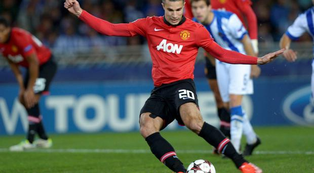 Manchester United's Robin van Persie kicks the ball to miss a penalty shot during their Champions League soccer match against Real Sociedad at Anoeta stadium in San Sebastian