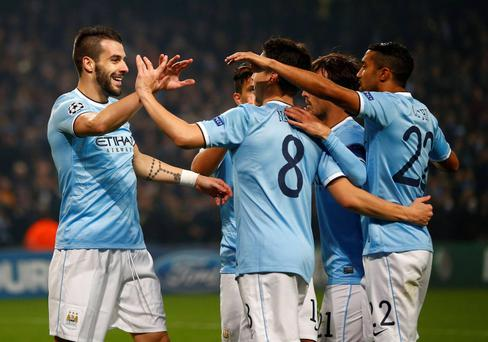 Manchester City's Alvaro Negredo (L) celebrates with team-mates after scoring his second goal against CSKA Moscow during their Champions League soccer match at the Etihad Stadium in Manchester, northern England, November 5, 2013. REUTERS/Darren Staples (BRITAIN - Tags: SPORT SOCCER)
