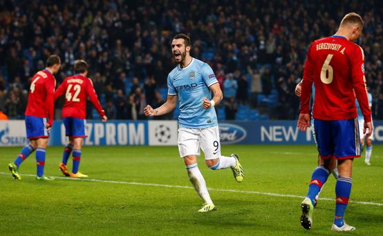 Manchester City's Alvaro Negredo (2nd R) celebrates scoring his third goal against CSKA Moscow during their Champions League soccer match at the Etihad Stadium in Manchester