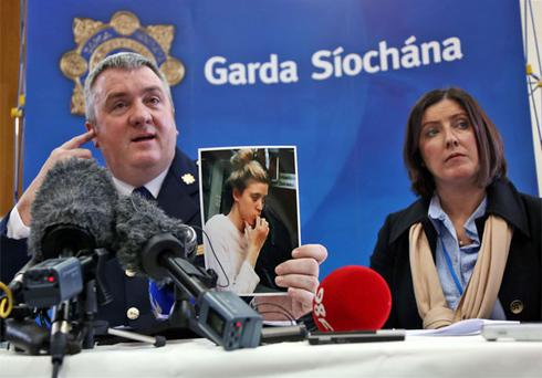 Superintendent David Taylor of the Garda Press Office and Orla Ryan, Guardian Ad Litem of the girl with a Garda hand out picture of the Australian woman